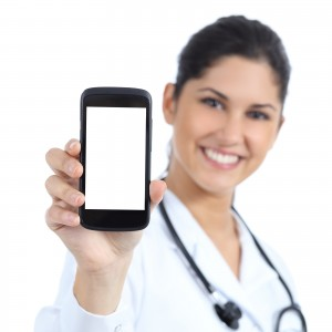 Beautiful Female Doctor Smiling And Showing A Blank Smart Phone
