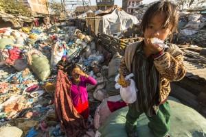 KATHMANDU, NEPAL - CIRCA DEC, 2013: Unidentified child and his p