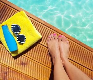 Summer holiday fashion selfie concept - woman on a wooden pier a
